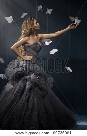 Beauty Blonde Woman On The Fog With Butterflies