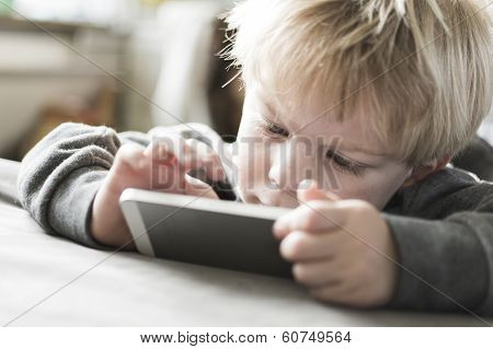 Boy playing on smartphone