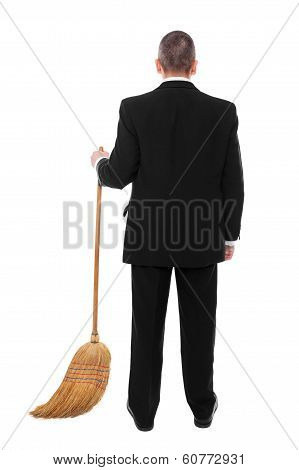 Businessman With Broom