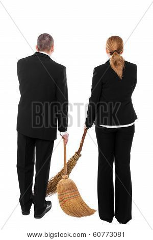 Two Business People With Brooms
