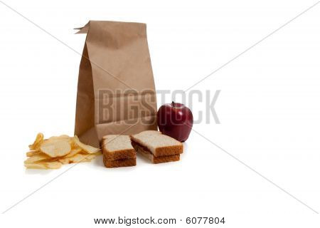 A Sack Lunch With Peanut Butter Sandwich