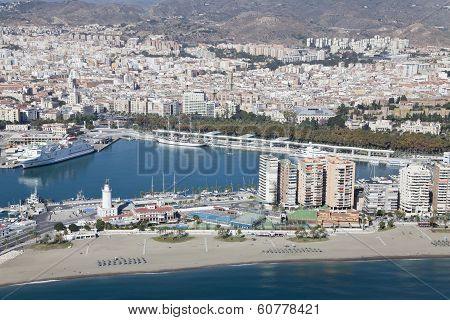 Malaga Harbor With Its Downtown At The Back Seen From Air.