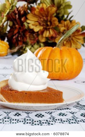 Slice Pumpkin Pie With Lots Of Whip Cream