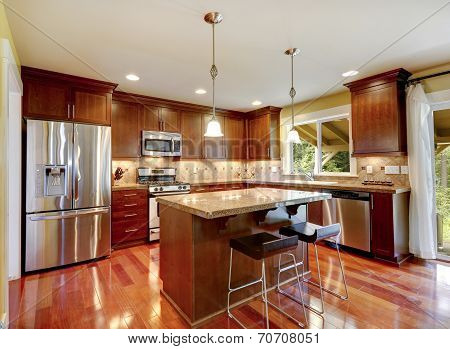 Shiny Kitchen Room With Granite Tops And Steel Appliances