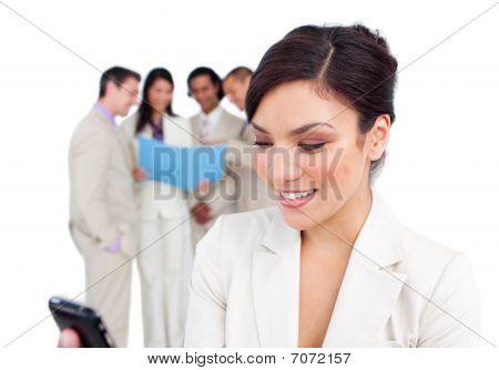 Portrait Of A Pretty Businesswoman Sending A Text