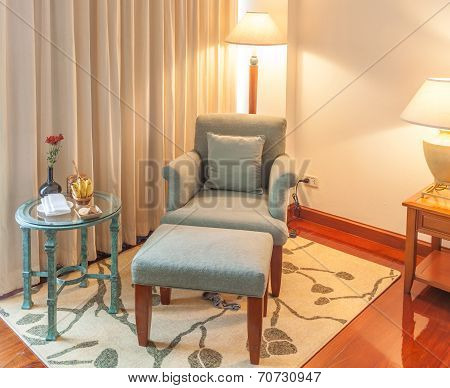 Relaxing Corner, Reclining Armchair, Ottoman And Table In Hotel Bedroom