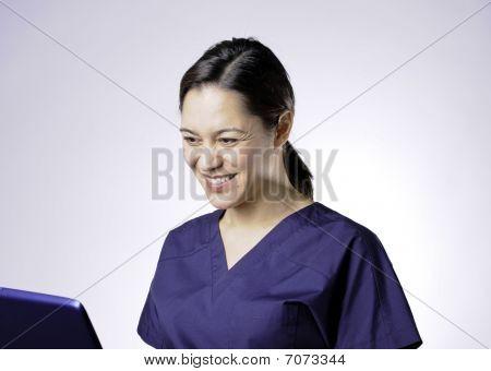 Smiling Asian Medical Assistant.