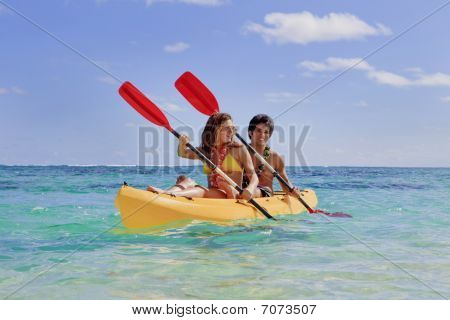 young couple with a kayak
