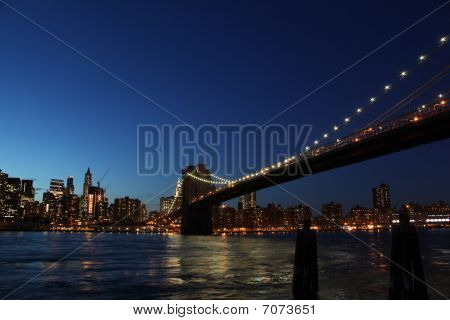 Downtown Manhattan, Brooklyn Bridge New York At Night During Blue Hour