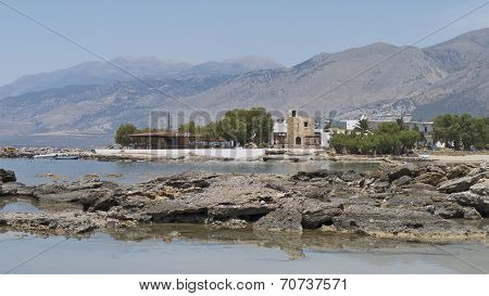 A taverna at Frangokastello and the dramatic mountains of southern Crete, Greece.
