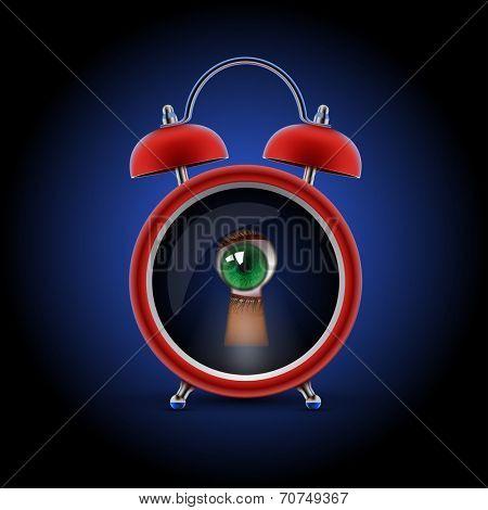 red alarm clock with keyhole eye