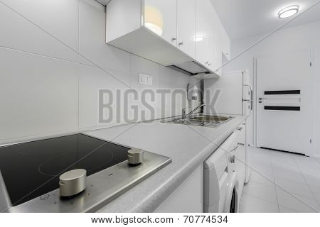 Small And Compact Kitchen In White