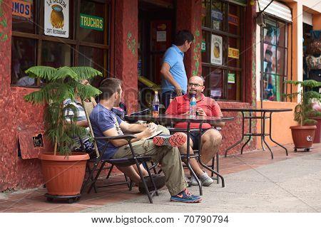People at Outdoor Table in Banos, Ecuador