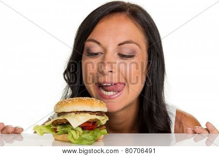 a young woman with a hamburger. fast food and fast food