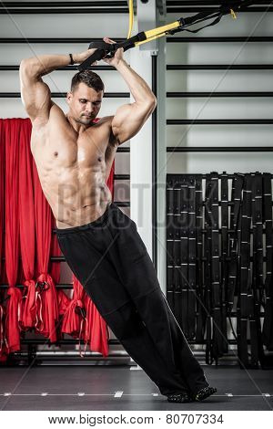 Young man streching muscles making functional training