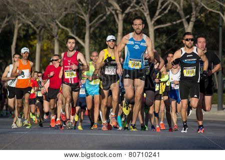 VALENCIA, SPAIN - JANUARY 11, 2015: Runners compete in the 2015 Valencia 10K Divina Pastora Run in Valencia, Spain.