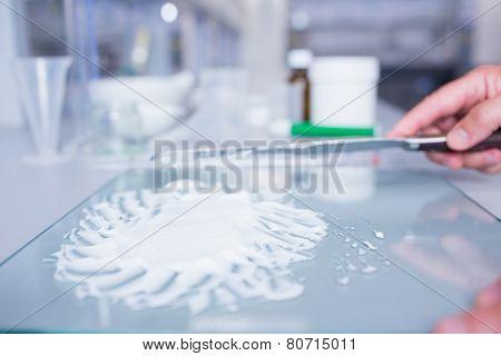 Close up of a biochemist preparing some medicine in laboratory