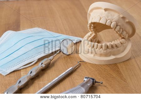 Open Dental Mold Of Teeth With Implements