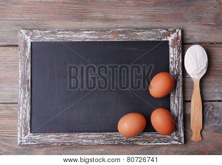Blackboard blank on rustic wooden planks background