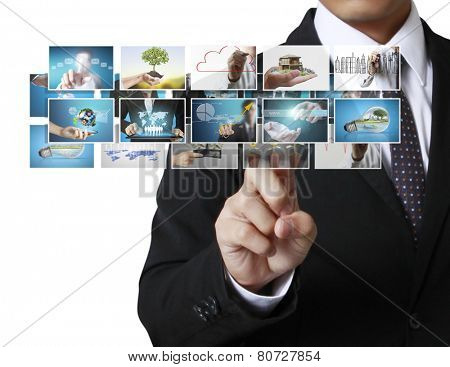 Businessman touch screen to choose digital photos