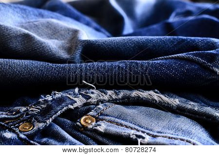 Background of denim blue color with scuffs items poster