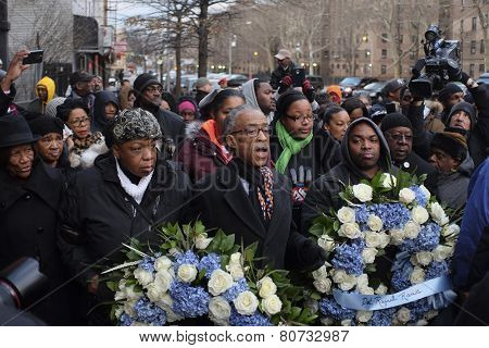 Rev Sharpton with wreaths