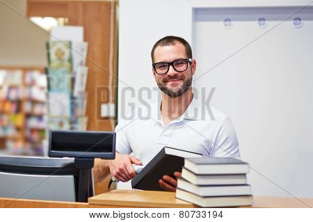 Salesman At The Checkout In A Bookstore