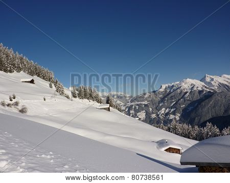 Ski huts in alpine winter landscape