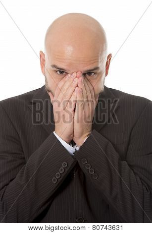 Businessman Covering His Face With His Hands In Stress Waiting For Bad News Or Disaster At Work