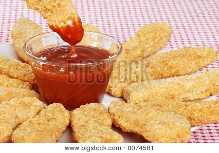 closeup BBQ sauce with chicken fingers
