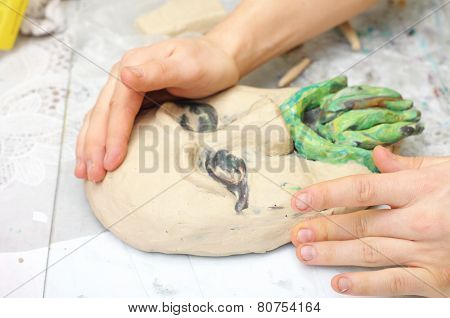 Hands sculpting craft with plasticine the form of face with moustache poster