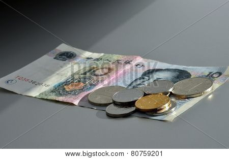 Chinese currency. Coins and ten Yuan bank note.