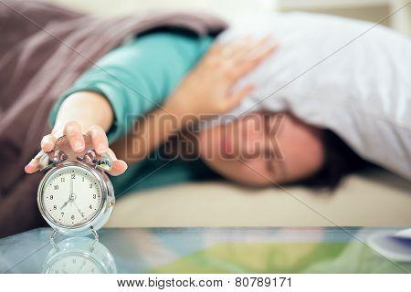 Woman's hand off the alarm clock.