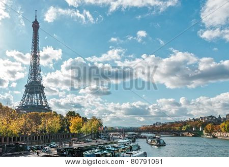 PARIS, FRANCE - NOVEMBER 05, 2014: Paris the Eiffel Tower and the Seine River in the fall on a sunny