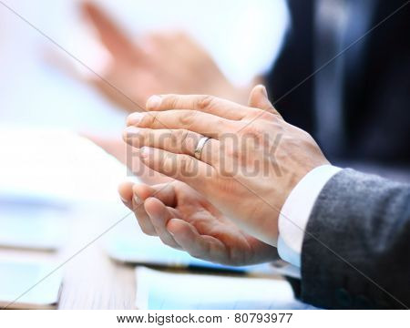 Close-up of business people clapping hands. Business seminar concept