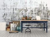 3D Rendering of Interior of an artist or designer studio with blank canvasses, picture frames and supplies on a simple black wood work table with a stool against an abstract patterned grey wall poster