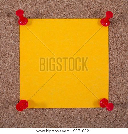 Blank Orange Note Paper Pinned To A Noticeboard