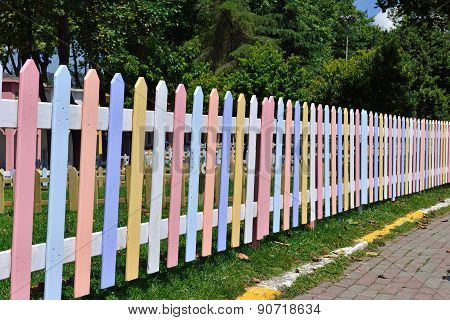 wooden fence painted in bright colors