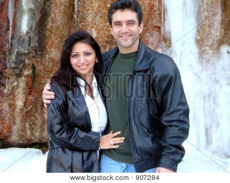 Couple And Icy Waterfall