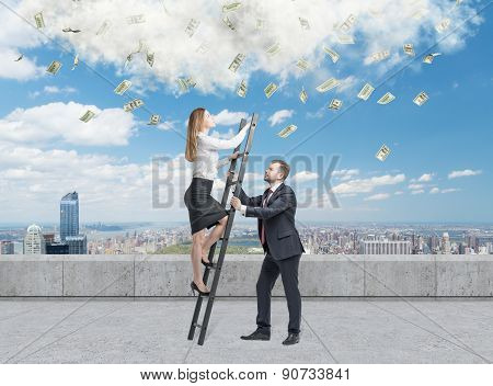 Businessman holds a ladder for the business lady. The concept of the teamwork. On the roof terrace in Manhattan. Dollar notes falling from the sky. poster