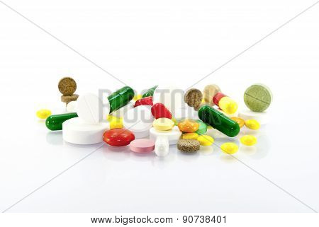 Many Different Tablets And Capsules Isolated On A White Background.