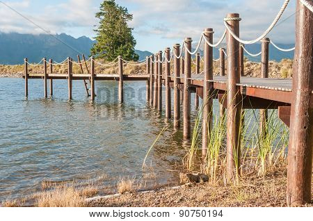 Repeating Pattern Of Wooden Poles In A Jetty