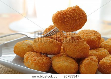 chicken nuggets served in a white bowl