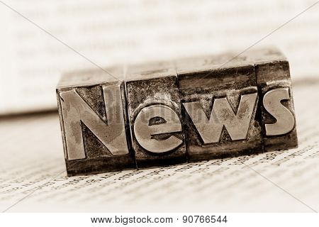 the word news written with lead letters. symbolic photo for newsletters, newspapers and information poster