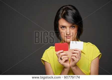 Business woman showing blank credit cards