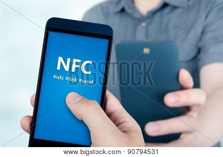 Hand Holding Smartphone With Nfc Technology - Near Field Communication Data Transfer Method