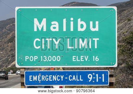 Malibu, California, USA - April 14, 2015:  Malibu city limit sign on busy Pacific Coast Highway in Southern California.