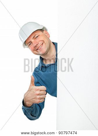 A Man In A Construction Helmet Shows Gesture Ok