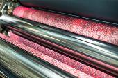 Water roller on offset printing press machine. Romayor machine poster