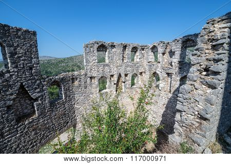 ruins of medieval fortress in Pocitelj village in Bosnia and Herzegovina poster